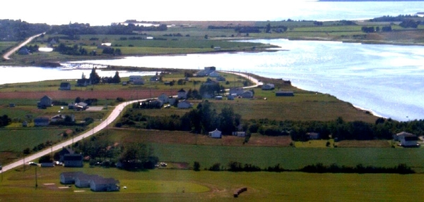 aerial-view-of-a-view-to-sea-cottages-bottom-left-darnley-bay-darnley-bridge-and-malpeque